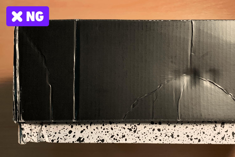 ボックス面に大きな凹みやシワがある